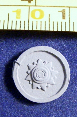 ACR46 round shield with sun motif